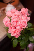 Bouquet of pink roses with lamplight — Stock Photo