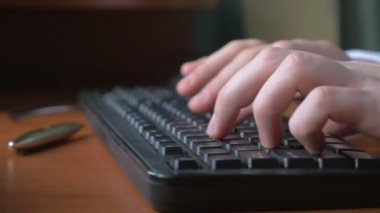 Close-up of a young man hands typing on a laptop keyboard — Stock Video