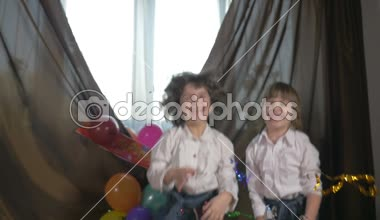 Young beautiful twin sisters dancing at a birthday party with confetti, slow motion — Stock Video