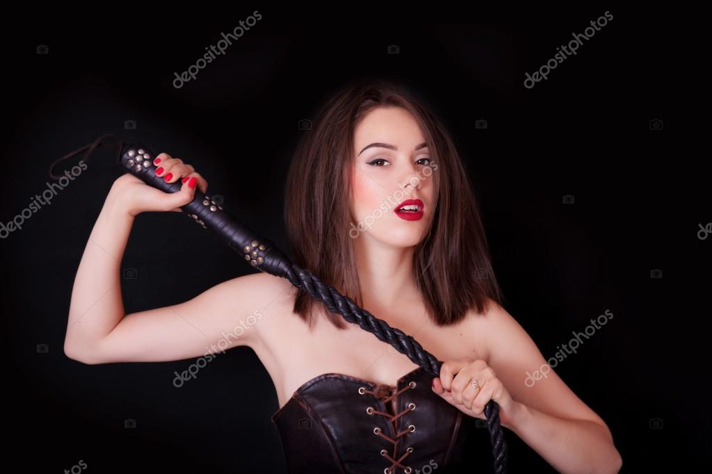 Domina in leather whips her slave 3