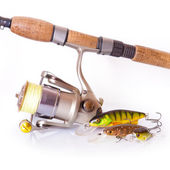 Spinning rod and reel with wobbler lure — Stock Photo