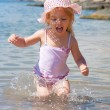 Little girl running beach shore splashing water — Stock Photo #53461289