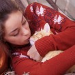 Cute girl kisses a red cat — Stock Photo #60073359