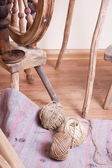Distaff and skeins of thread — Stock Photo