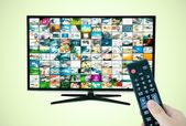 Widescreen high definition TV screen with video gallery. Remote  — Stock Photo