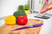 Fresh vegetables on a chopping board in the kitchen — Stock Photo