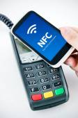 Contactless payment card with NFC chip in smart phone — Stock Photo