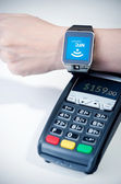 Man using smart watch with NFC chip. Fast contactless payment  — Stockfoto