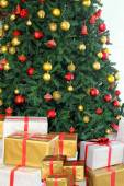 Christmas tree and presents under it — Stock Photo
