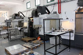Small workshop with machines cnc — Stock Photo