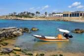 Fishing boat at ancient port Caesarea, Israel — Stock Photo