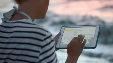 Woman with tablet by sea — Stock Video