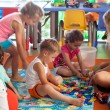 Children playing games in nursery — Fotografia Stock  #56150217