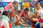 Children playing games in nursery — Stock Photo