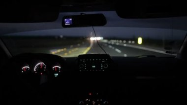 Car driving at night or early morning — Stockvideo