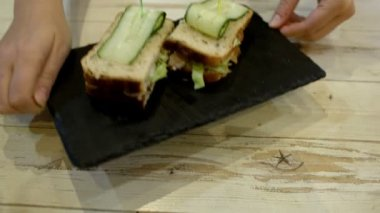 Serving a portion of sandwiches in cafe — Vídeo de stock