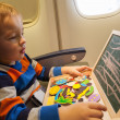 Boy in the plane drawing on board with chalk — Stock Photo #63500973