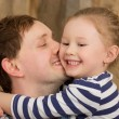 Happy father kissing little daughter — Stock Photo #70032343
