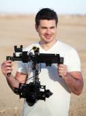 Smiling man with steadicam equipment outdoor — Stock Photo