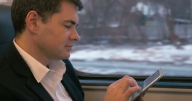 Businessman Traveling by Train with Tablet PC — Stock Video