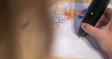 Woman drawing on paper with 3D pen — Wideo stockowe