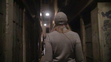 Woman Walking Along the Narrow Street — Stock Video