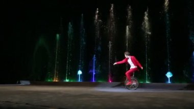 Male Circus Artist Riding a Monocycle during Performance — Stock Video