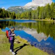 Woman while hiking checking map on cell phone — Stock Photo #56487653