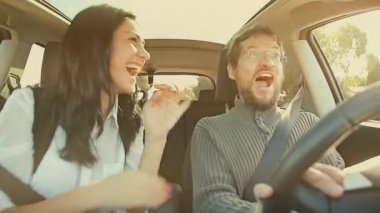 Woman and man dancing in car — Stockvideo