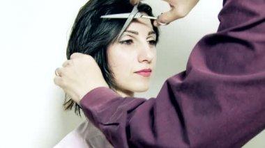 Female model getting  haircut — Stok video