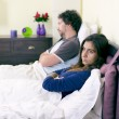 Unhappy couple in bed after fight not talking retro style — Stock Photo #65147225