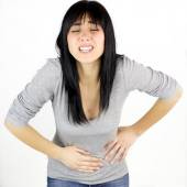 Woman with strong menstruation pain — Stock Photo