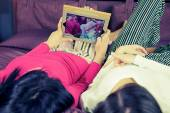 Happy girlfriends in bed taking selfie with tablet funny — Stock Photo