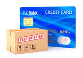 Cardboard box and credit card — Stock Photo