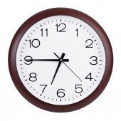 Clock shows a quarter to seven — Стоковое фото