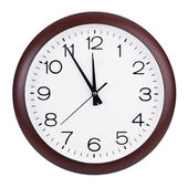 Round clock shows five minutes to twelve — Stock Photo