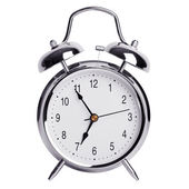 Five minutes to seven on a round alarm clock — Stock Photo