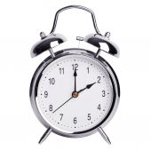 Two hours on a round alarm clock — Stock Photo