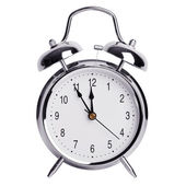 Five minutes to twelve on a alarm clock — Stock Photo
