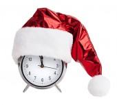 Santaklaus cap on a round alarm clock — Stock Photo