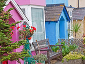 Brightly painted cottages — Stock Photo
