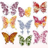Vector set of abstract swirl butterflies — Stock Vector