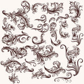 Vector set of floral swirls in vintage style — Vector de stock