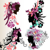 Fashion abstract female face silhouettes with floral hairstyle — Stok Vektör