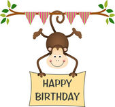 Hanging monkey holding a happy birthday sign — Stock Vector