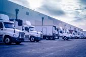 Trucks loading unloading at warehouse — Stock Photo