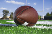 American football on find with goal posts — Stock Photo