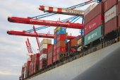 Fragment of large container ship docked at Container Terminal — Stock Photo