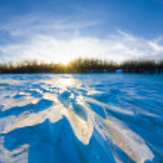 Sunset over a frozen snowbound plain — Stock Photo #55478527