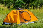 Orange tent on a forest glade — Stock Photo